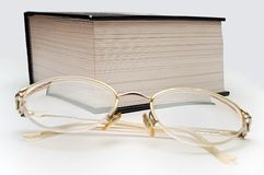 GLAS AND BOOK. PHOTO WITH reading glasses AND BOOK ON THE SHIT Stock Photo