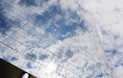 Glas-building reflection. Large glass-building and reflecting clouds and sky Royalty Free Stock Images
