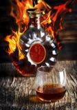 Glas Cognac en fles Cognac royalty-vrije stock fotografie