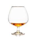 Glas cognac of whisky op wit Royalty-vrije Stock Afbeeldingen