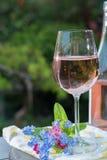 Glas of cold rose wine, outdoor terrase, sunny day, spring garde Stock Photos