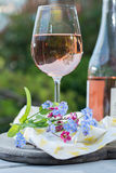 Glas of cold rose wine, outdoor terrase, sunny day, spring garde Royalty Free Stock Photography