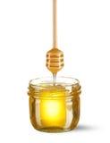 Glas des Honigs und des Schöpflöffels Stockbild