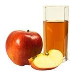 Glas des Safts und des Apfels Stockbild