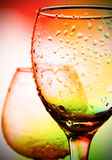 Glas with drop on it. Glas with color drop on it Royalty Free Stock Images