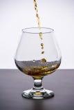 Glas dure cognac royalty-vrije stock afbeeldingen