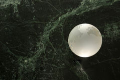 A glass earth. A glas earth orb on a 'universe' background stock photos