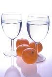 Glas en sinaasappelen Stock Afbeeldingen