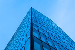 Glas front of an office building at night Stock Photography