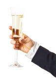 Glas funkelnder Champagner in der Hand Lizenzfreie Stockfotos
