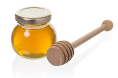 Glas Honig mit Schöpflöffel Stockbild