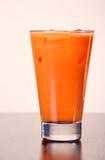 Glas Karottensaft stockbild
