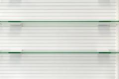 Glas lege planken Royalty-vrije Stock Afbeeldingen
