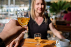 Glas of liqueur with girl Royalty Free Stock Image