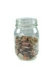 Glas Münzen auf einem weißen Hintergrund. Lizenzfreies Stockfoto