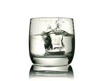 Glas met een stuk van ijs Stock Foto
