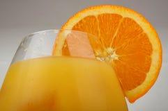Glas met jus d'orange Stock Afbeeldingen