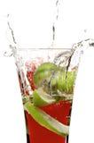 Glas met sap en kalk Stock Fotografie