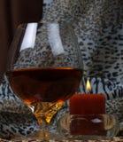 Glas mit einem swizzle Lizenzfreie Stockfotografie