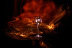 Glas mit Feuer Stockbild