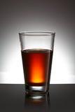 Glas mit Flüssigkeit Lizenzfreies Stockfoto