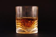 Glas mit Flüssigkeit auf getrennt Lizenzfreies Stockbild