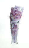 Glas mit Geld Lizenzfreies Stockbild