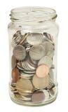 Glas mit Geld Stockfotos