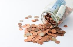 Glas mit Geld Lizenzfreies Stockfoto