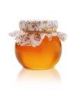 Glas mit Honig Stockfotografie