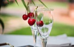 Glas mit Kirsche Stockbilder