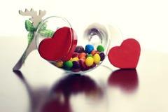 Glas mit Süßigkeitspille Stockfoto