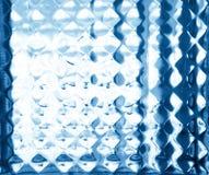 Glas in reliëf gemaakt patroon in blauwe tonen. Glashulp. Royalty-vrije Stock Afbeelding