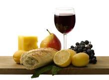 Glas rode wijn en fruit Stock Afbeeldingen