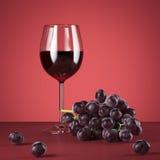 Glas rode wijn en verse druiven het 3d teruggeven Stock Foto's