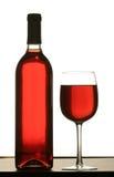 Glas Rotwein mit Flasche Wein Lizenzfreies Stockbild