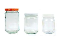 Glas- und Plastikbehälter Stockbild