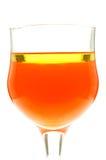 Glas van gele vloeistof met olie op de oppervlakte Stock Afbeelding