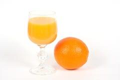 Glas van Jus d'orange en een Sinaasappel Royalty-vrije Stock Fotografie