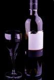 Glas van Rode Wijn en Fles Stock Foto