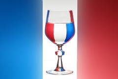 Glas van wijn frech vlag stock afbeeldingen