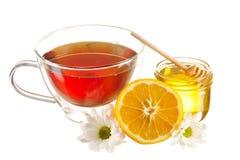 Glas von Honig- und Teecup Lizenzfreie Stockbilder