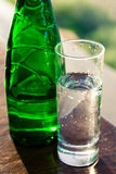 Glas of water and bottle Royalty Free Stock Photo