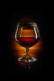 Glas Weinbrand und Korken Lizenzfreie Stockfotos