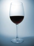 Glas of wine. Red wine on blue background Royalty Free Stock Images