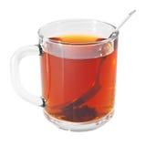 Glascup mit schwarzem Tee und Löffel Lizenzfreies Stockbild