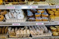 Glaserade och fyllda donuts Fotografering för Bildbyråer