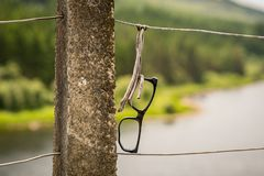 Glases frame on a fence. Glasses frame, seen near Capel Curig, Conwy, Wales, UK Royalty Free Stock Photography