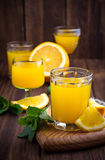 Glases of orange juice with mint Stock Images
