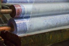 Glasfiberingrepp som gör maskinen, byggnadsmaterial för väggisolering royaltyfria foton